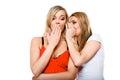 Gossiping friends, two women sharing a secret Royalty Free Stock Photo