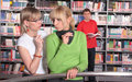 Gossips in library Stock Image