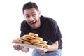 Got the burgers a young happy man holding a plate full of cheesburger cheeseburger to be exact Royalty Free Stock Photo