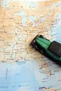 Got wheels will travel photograph showing toy model green vintage car placed map north america showing canada united states Stock Image