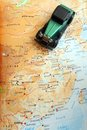Got wheels will travel photograph showing toy model green vintage car placed near top map china mainland showing different Stock Photo