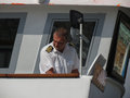 Swedish navy sailor overste piloting a ferry Royalty Free Stock Photo