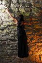 Goth girl climbing a wall Royalty Free Stock Photography
