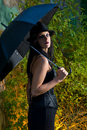 Goth woman holding umbrella Stock Image