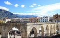 Gothic aqueduct in sulmona town italy market at piazza garibaldi the largest square the italian of at the foot of the maiella Royalty Free Stock Image