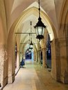 Gothic arcades by night of cloth hall sukiennice on main market square in krakow Royalty Free Stock Photo