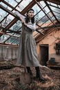 Gothic brunette model in dress keep shovel. Victorian fashion. Gothic model on grunge background. Mysterious brunette woman with Royalty Free Stock Photo