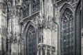 Gothic cathedral detail with windows and sculptures Stock Photos