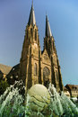 Gothic church with water fountain in fore ground Royalty Free Stock Image