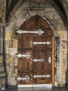 Gothic doorway wooden with metal fitting Royalty Free Stock Photo