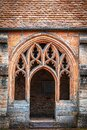 Gothic entrance to shale tiled medival  clorister with arches Royalty Free Stock Photo
