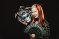 Gothic girl with fan and a mask portrait of redheaded on black background Royalty Free Stock Image