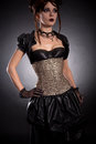Gothic girl in victorian style outfit and rose corset studio shot Royalty Free Stock Photo