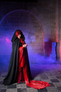 Gothic lady in medieval castle beautiful victorian woman red standing a smokey dark Stock Photo