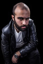 Gothic a masculine bearded man isolated over a black background Stock Photo