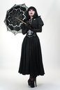 Gothic vampire in black dress with umbrella Royalty Free Stock Image