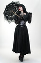 Gothic vampire girl in black dress with umbrella Royalty Free Stock Photo
