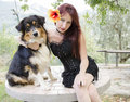 Gothic woman with australian shepherd dog portrait of Royalty Free Stock Photos