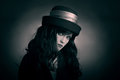 Gothic woman in black hat portrait of young looking brunette Royalty Free Stock Photography