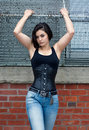 Gothic woman in corset halloween portrait of a beautiful stylish young asian brunette girl with shirt haircut black and blue jeans Stock Photos