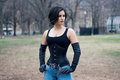 Gothic woman in corset halloween portrait of a beautiful stylish young asian brunette girl with shirt haircut black gloves and Royalty Free Stock Photography