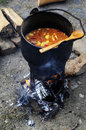 Goulash cooked over open fire as middle ages Stock Photos