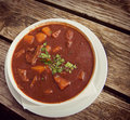 Goulash soup at beer garden, traditional Bavarian food Royalty Free Stock Photo