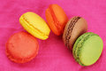 Goup of macaroons over pink group colorful on bright cloth Stock Photo