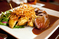 Gourmet beef frites with potatoes and salad Royalty Free Stock Photography