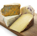 Gourmet cheese assortment on a wooden board Stock Images