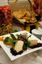 Gourmet cheese plate with garnishes Royalty Free Stock Photos