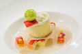 Gourmet cheesecake with cream sauce and fruit sticks Royalty Free Stock Photo