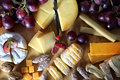 Gourmet cheeses cheese on wooden board Royalty Free Stock Photo