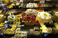 Gourmet desserts in grocery store variety of with colorful decorations a Royalty Free Stock Image