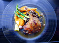 Gourmet duck dish confit de canard a photograph showing the french cuisine of or leg slow cooked in oil and roasted served on Stock Photography