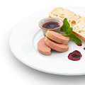 Gourmet fresh foie gras pate on white served with ciabatta berry sauce and basil leaf Stock Photos