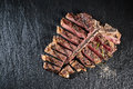 Gourmet grilled and sliced porterhouse steak Royalty Free Stock Photo