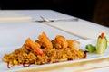 Gourmet lemony risotto recipe on white plate close up rectangular emphasizing tasty prawns top Royalty Free Stock Photo