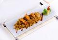 Gourmet lemony risotto recipe on white plate close up rectangular emphasizing tasty prawns top Royalty Free Stock Photography