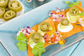 Gourmet nachos tortilla chips topped with sour cream guacamole pico de gallo and jalapeno Royalty Free Stock Photos