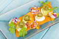 Gourmet nachos tortilla chips topped with sour cream guacamole pico de gallo and jalapeno Royalty Free Stock Photo