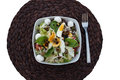 Gourmet nutritional food on bowl on round placemat high angle view of salad with eggs placed top of brown against white background Stock Photo