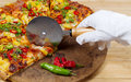 Gourmet pizza being prepared to Serve Royalty Free Stock Photo