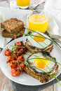 Gourmet vegetarian brunch with fried egg and mushroom Stock Images