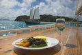 A gourmet West Indian meal prepared onboard a traditional schooner Royalty Free Stock Photo
