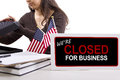 Goverment shutdown woman with a desk sign showing closed for business Royalty Free Stock Photo