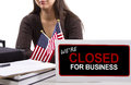 Goverment shutdown woman with a desk sign showing closed for business Royalty Free Stock Photography