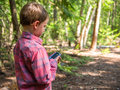 Gps geocache boy using to find Stock Photos