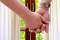 Grab hand to the door people dorr for view or go outside Stock Photo
