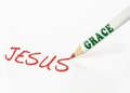 Grace spells jesus a labeled pencil writing the word Royalty Free Stock Photography